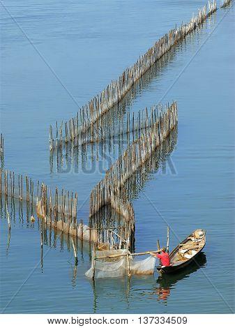 Hue, Vietnam, August 18, 2015 fishermen, Hue, Vietnam, dropping fishing nets, the Tam Giang