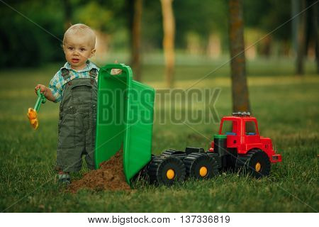 photo of little funny constructor with shovel