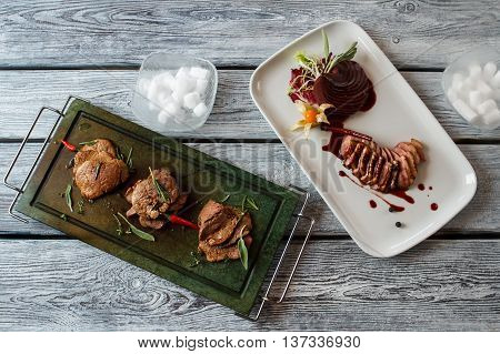 Cooked meat with spices. Slices of brown meat. Duck steak and veal medallions. Food with incredible taste.