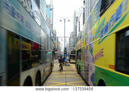 HONG KONG - NOV 10: Double deck buses on Nathan Road in Kowloon, Hong Kong. Nathan Road is a main commercial thoroughfare on Nov 10, 2015 in Kowloon, Hong Kong.