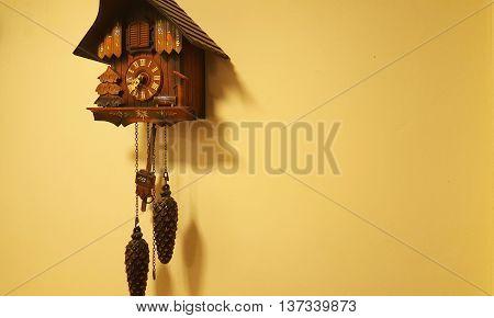 Brown wood cuckoo clock on a wall