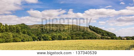 Battlesbury Hill in Wiltshire panorama. Site of Iron Age fort on the edge of Salisbury Plain near the town of Warminster in England UK
