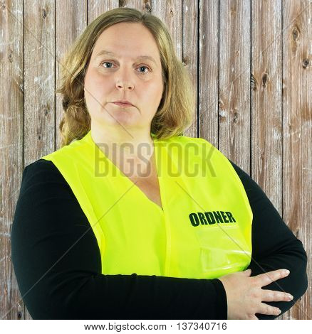 Security Woman isolated in a yellow folder vest