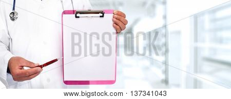 Hands of medical doctor with a clipboard.