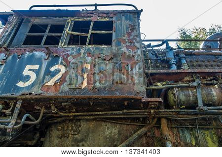 A closeup shot of an old derelict rail car.