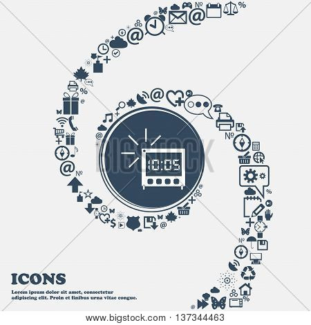 Digital Alarm Clock Icon Sign In The Center. Around The Many Beautiful Symbols Twisted In A Spiral.