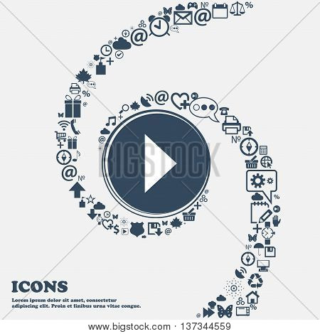 Play Button Icon Sign In The Center. Around The Many Beautiful Symbols Twisted In A Spiral. You Can