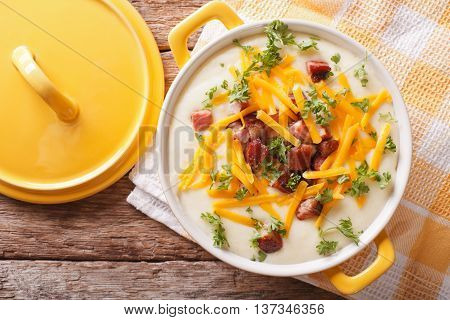 Cream Potato Soup With Bacon And Cheddar Cheese Close-up. Horizontal Top View