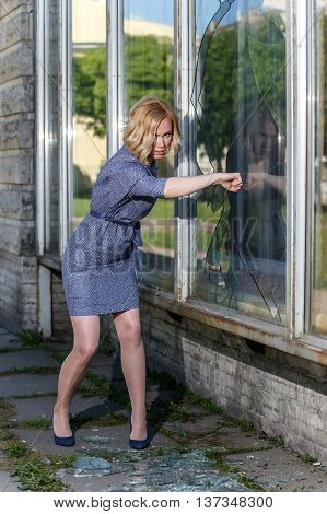 Very Angry Woman Braking Glass Window By Her Fist