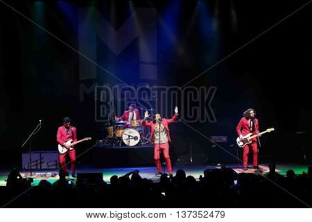 HUNTINGTON, NY-MAR 7: (L-R) Mark Pellizzer, Alex Tanas, Nasri and Ben Spivak of the reggae fusion band Magic! performs in concert at The Paramount on March 7, 2015 in Huntington, New York.