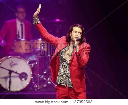 HUNTINGTON, NY-MAR 7: Singer Nasri (R) of the reggae fusion band Magic! performs in concert at The Paramount on March 7, 2015 in Huntington, New York.