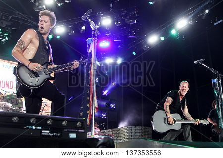 NASHVILLE-JUL 11: Singers Tyler Hubbard (R) and Brian Kelley of Florida Georgia Line perform during Luke Bryan's 'Kick The Dust Up' Tour at Vanderbilt Stadium on July 11, 2015 in Nashville, Tennessee.