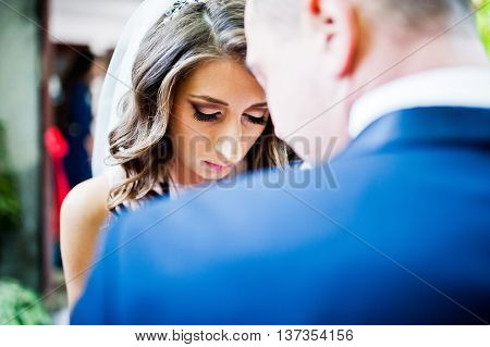 Bride Wears A Buttonhole For Her Groom