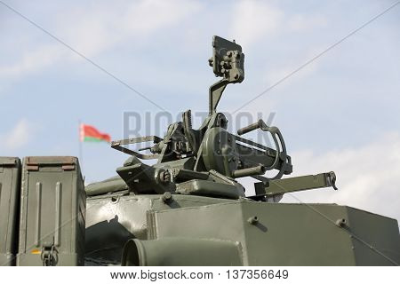 photographed close-up of old military equipment the Soviet Union, . in the background is out of focus Belarusian flag