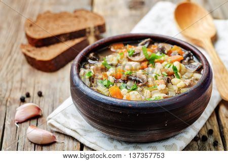 white bean soup mushrooms on a dark wood background