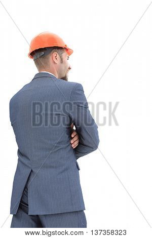 Architect with arms folded from the back - looking at something over a white background