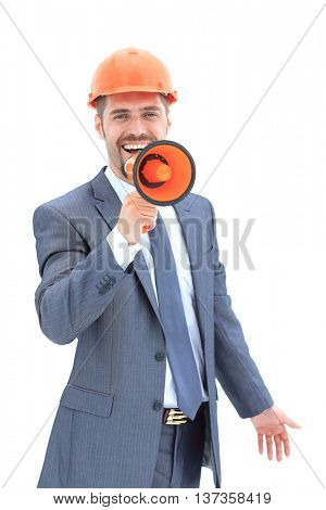 Portrait of young architect  shouting using megaphone over white background