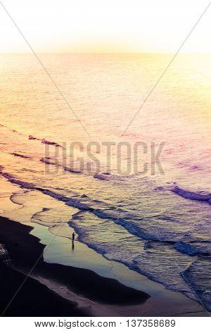 Beach Shoreline At Sunrise