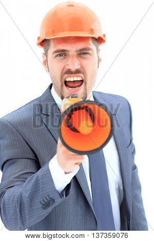 Portrait of angry architect  shouting using megaphone over white background