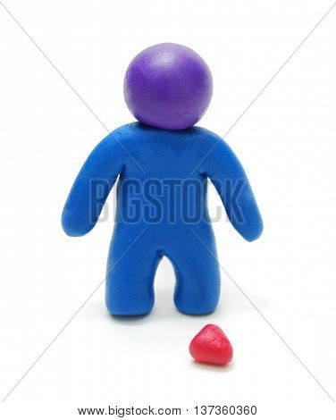 3D Blue Plasticine Man Figure Standing in Sadness near Dropped Red Heart