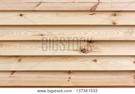 Wood planks. Kiln dried wooden lumber texture background. Unpainted unfinished pine furniture surface. Timber hardwood wall.