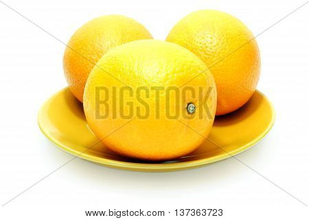 Three Isolated Oranges on the Plate on White Background