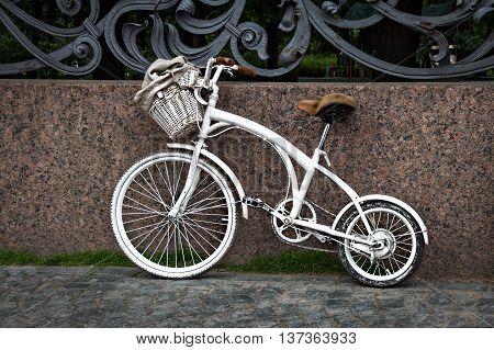 White vintage two-wheeled bike on the street