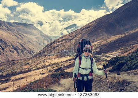 Female hiker enjoying a walk. Annapurna circuit trek in Nepal.