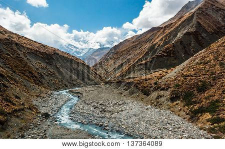 Crystal clean glacier river flowing through a valley. Annapurna region in Himalaya.