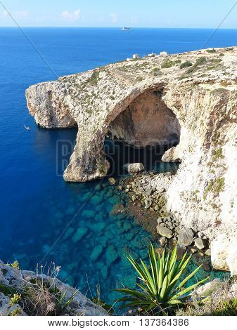 Natural arch of Blue Grotto in Malta.