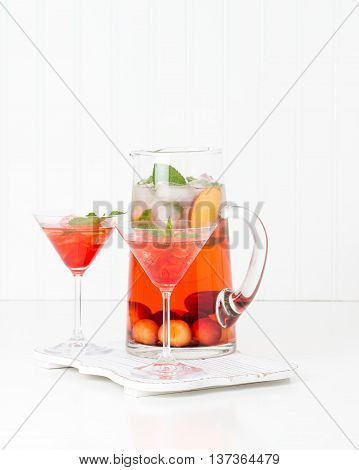 Delicious cocktail made with fresh chrries and peaches.