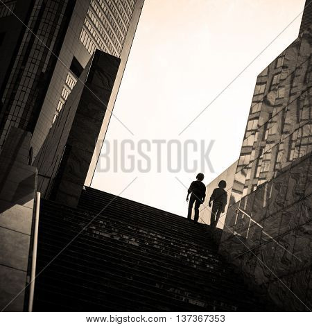 Street photography in Tokyo, detail of the architecture and silhouettes figure in the Ginza district. Negative space area for text.