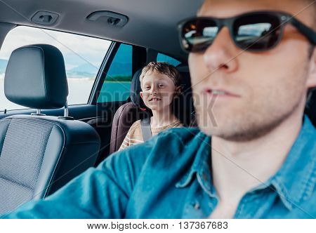 Happy long jorney in car with father