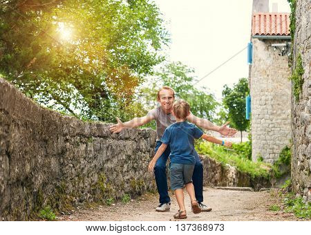 Son runs to his daddy to embrace him