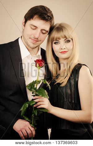 Date flirt and love concept. Valentine's Day. Attractive blonde woman with handsome man dating. Elegant glamorous couple pare fall in love.