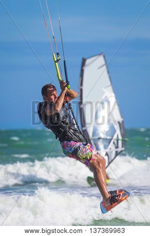 Athletic Man Riding On Kite Surf Board Sea Waves
