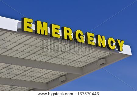 Yellow Emergency Entrance Sign for a Local Hospital VIII
