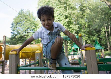 Afro American School Boy Plays On Playground