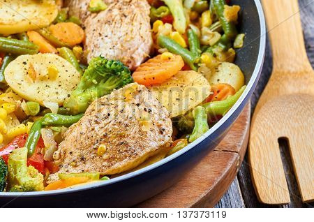 Stir fry chicken fillet with vegetables and herbs