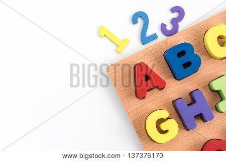 Colorful wood alphabet letters and number (1 2 3) isolated on white paper background with copy space include clipping path for design work Education kids concept