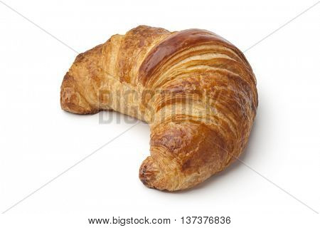 Single fresh baked croissant on white background