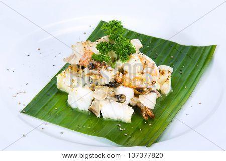 Shrimp fish meat squid shellfish and mushrooms salad dressingThai food in a luxury hotel.