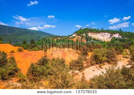The reserve is in place on the career of ocher mining. Orange and red picturesque hills. Languedoc - Roussillon, Provence, France