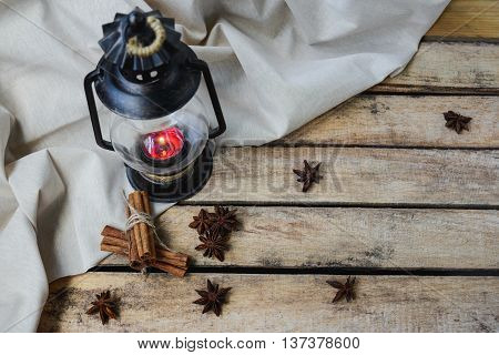 autumn comfort concept still life of candlestick cinnamon and star anise