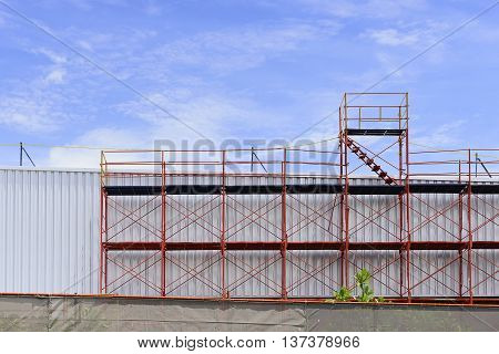 The red scaffold at the factory building between renovate process