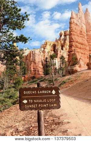 BRYCE CANYON, UTAH - AUGUST 17, 2015: Direction sign on the Queens Garden Trail in the Amphitheater area of Bryce Canyon National Park, Utah.