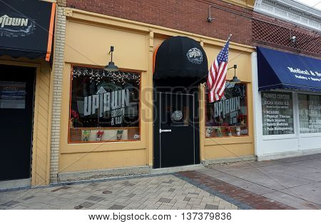 PLAINFIELD, ILLINOIS / UNITED STATES - DECEMBER 29, 2015: The Uptown Eatery and Tap offers food and booze in historic downtown Plainfield.