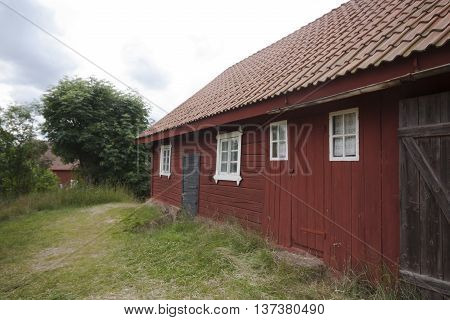 an old barn in the typical swedish red colour