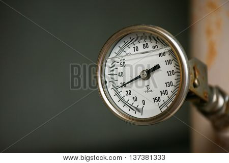 Pressure gauge in oil and gas production process for monitor condition, The gauge for measure in industry job, Industry background and close up gauge , gauge for measure pressure in the process.