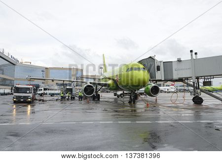 MOSCOW, RUSSIA - MAY 19, 2016: Airbus A319 S7 airlines refueling aircraft during preflight maintenance at the airport Domodedovo